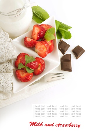 Strawberry with a mint and jug of milk, chocolate Stock Photo - 14209196