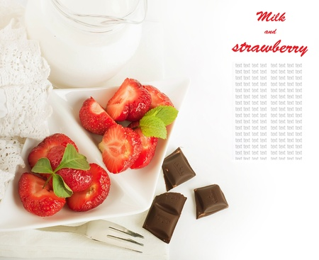Strawberry with a mint and jug of milk, chocolate Stock Photo - 14209179