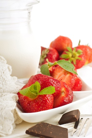 Strawberry with a mint and jug of milk, chocolate photo