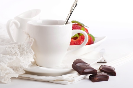 Strawberry with a mint and cup of coffee, chocolate photo