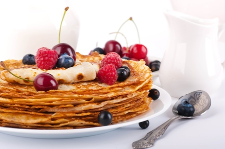Pancakes with berries and jug of milk Stock Photo - 14267477