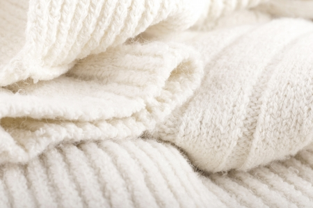 Structure of a woolen fabric, knitted warm things photo