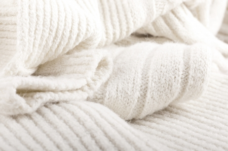 warm things: Structure of a woolen fabric, knitted warm things Stock Photo
