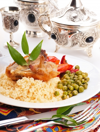 Couscous with green-stuffs and Arabic tableware, east kitchen photo