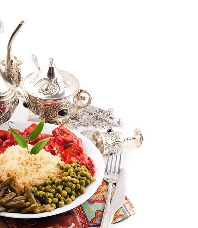 Couscous with green-stuffs and Arabic tableware, east kitchen Stock Photo