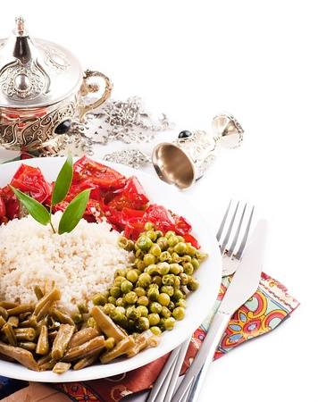 kuskus: Couscous with green-stuffs and Arabic tableware, east kitchen Stock Photo