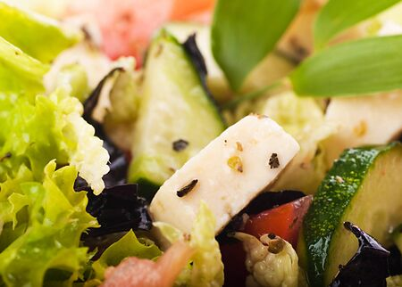 Salad from fresh green-stuffs and cheese with spices Stock Photo - 15657517