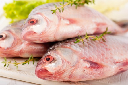 Raw European carp with a thyme and lemon, living fish Stock Photo - 16976704