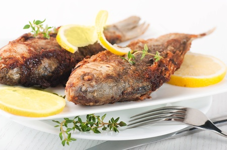 Raw European carp with a thyme and lemon, living fish Stock Photo - 16976740