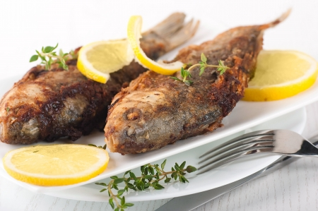 Raw European carp with a thyme and lemon, living fish Stock Photo - 16976724