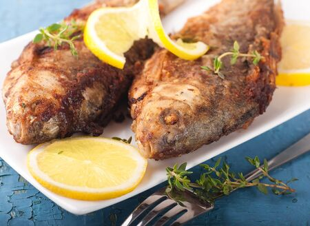 Raw European carp with a thyme and lemon, living fish Stock Photo - 16976747