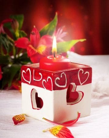 Red candle with heart and flower, a Valentines Day card photo
