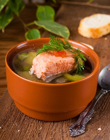 Fish a trout soup and bread with fennel photo