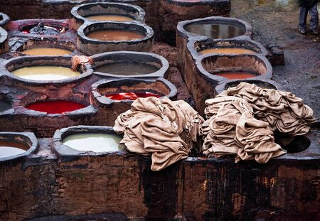 famous industries: The Moroccan leather factories, ancient craft in Medina of Fes Stock Photo