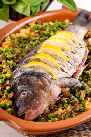 Baked crucian on a pillow from lentil and peas Stock Photo - 19244070