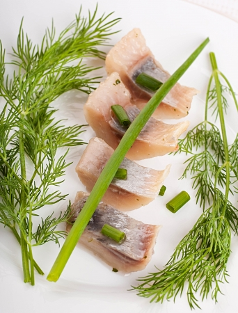 kipper: Herring marinaded with fennel on a white plate