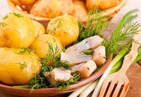 kipper: Herring marinaded with potato and fennel on a white plate