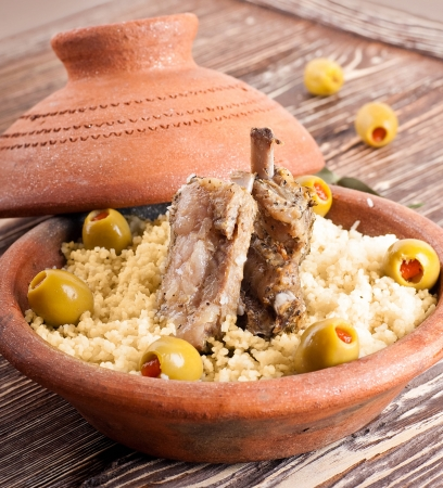 Moroccan tagine with lamb ribs, couscous and olives photo