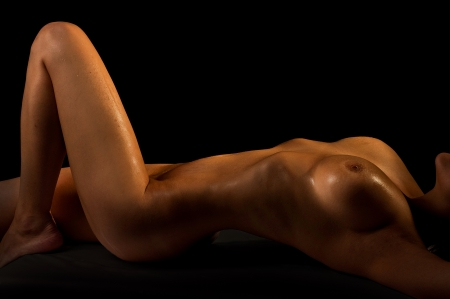naked female: The naked young girl on a black background
