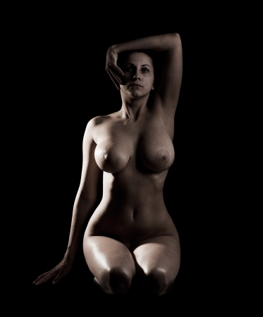 naked young girl: The naked young girl on a black background