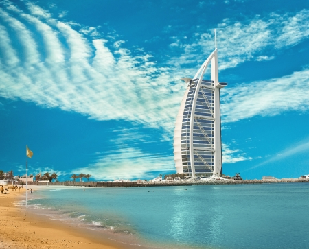 DUBAI - JUNE 4:  Burzh al Arab is well-known hotel on June 4, 2013 in Dubai. The hotel was constructed in the form of Dow's sail, the Arab vessel. Closer to top there is a helipad. One of the main sights of Dubai Éditoriale