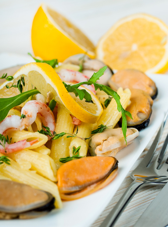 Pasta with mussels, shrimp and lemon, mediterranean cuisine photo