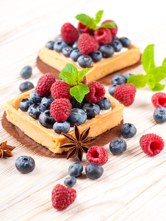 Blackberry tart with raspberries, mint and anise star photo
