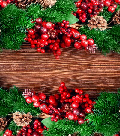 Christmas berries and spruce branch with cones photo