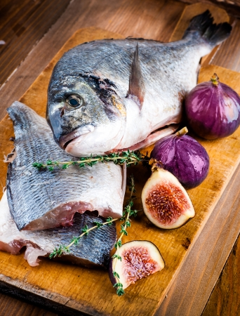 Dorado fish with lemon and figs, Mediterranean cuisine photo