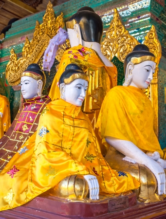 11th century: Statues of deities in the Buddhist temple. Shwedagon Pagoda was built in the 11th century