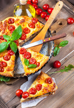 Pie with mozzarella, chicken and tomatoes. Italian food photo
