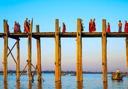 Mandalay - December 1: U-Bein Bridge December 1, 2013 in Mandalay. Monks crossing the river on the longest teak bridge in the world