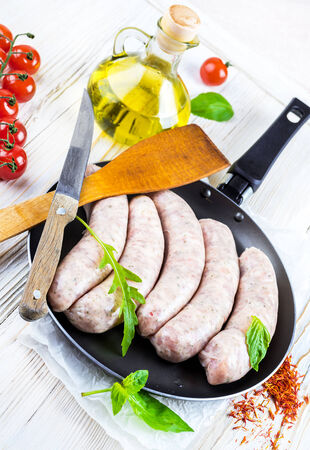 The Munich sausages with tomatoes and arugula photo