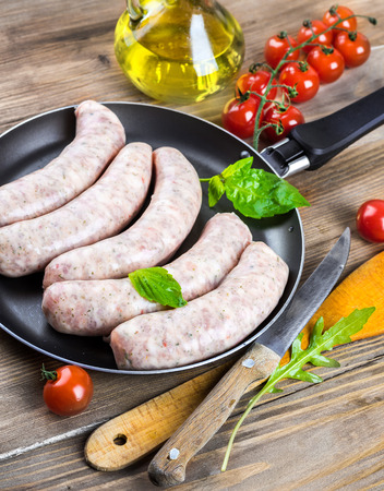 weisswurst: The Munich sausages with tomatoes and arugula Stock Photo