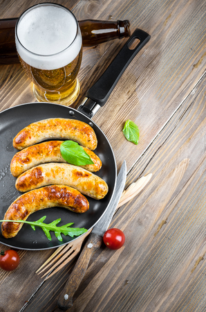 sweet mustard: The Munich sausages with tomatoes and arugula Stock Photo
