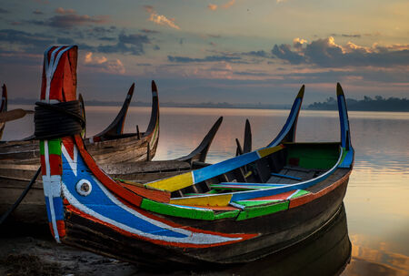 Colorful old boats on a lake in Myanmar photo