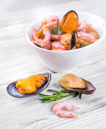 Mussels and shrimp in a white cup, seafood photo