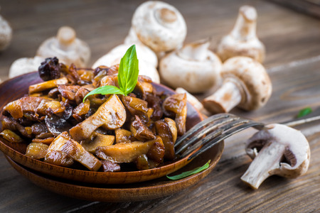 Fresh champignons on a wooden board photo