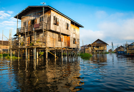inle: Ancient houses and their reflection in the water on the Inle Lake, Myanmar