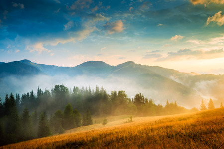 mountain: Amazing mountain landscape with fog and a haystack