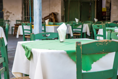 Greek island restaurants with colorful tables and chairs. photo