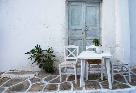 island: Greek island restaurants with colorful tables and chairs. Stock Photo
