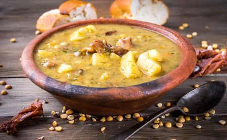 Pea soup with smoked chicken and herbs photo