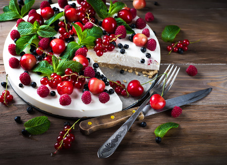 fruit plate: Cheesecake with berries and mint, summer dessert. Stock Photo