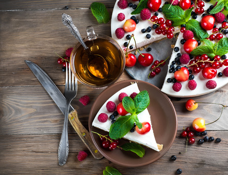 dessert plate: Cheesecake with berries and mint, summer dessert. Stock Photo
