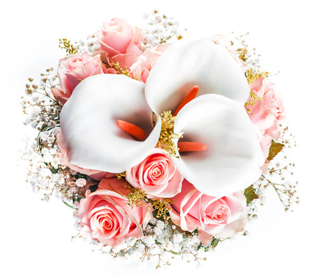 roses background: Bouquet for the bride of yellow roses and white calla lilies, floral background. Stock Photo