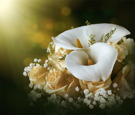 bridal: Bouquet for the bride of yellow roses and white calla lilies, floral background. Stock Photo
