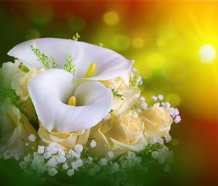 lilies: Bouquet for the bride of yellow roses and white calla lilies, floral background. Stock Photo