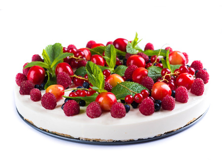 fruit cake: Cheesecake with berries and mint, summer dessert. Stock Photo