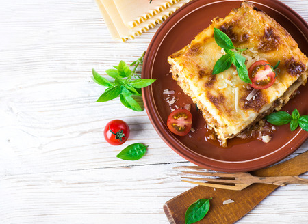 Italian lasagna, pasta dish with minced meat and parmesan cheese Foto de archivo